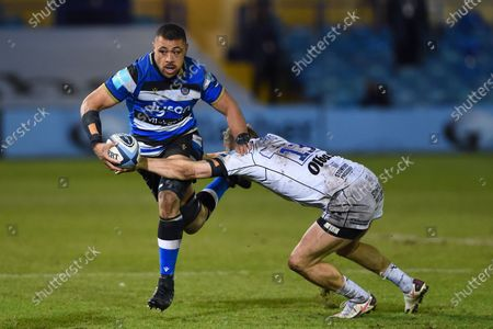 Stock Picture of Taulupe Faletau of Bath Rugby is tackled by Chris Harris of Gloucester Rugby