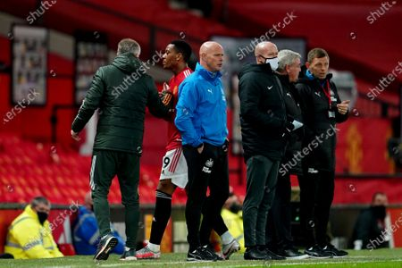 Anthony Martial of Manchester United shakes hands with Manchester United manager Ole Gunnar Solskjaer as he is substituted