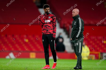 Stock Photo of Marcus Rashford of Manchester United with coach Nicky Butt during the pre-match warm-up