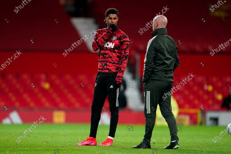 Stock Picture of Marcus Rashford of Manchester United with coach Nicky Butt during the pre-match warm-up