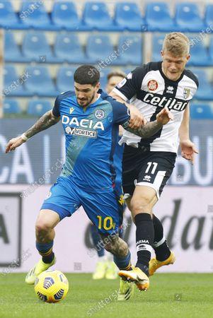 Parma's Andreas Cornelius (R) and Udinese's Rodrigo De Paul (L) in action during the Italian Serie A soccer match Parma Calcio vs Udinese Calcio at Ennio Tardini stadium in Parma, Italy, 21 February 2021.