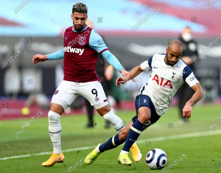 Tottenham's Lucas Moura, right, duels for the ball with West Ham's Said Banrahma during the English Premier League soccer match between West Ham United and Tottenham at the London Stadium in London