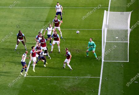 Tottenham's Lucas Moura, front left, scores his side's opening goal during the English Premier League soccer match between West Ham United and Tottenham at the London Stadium in London