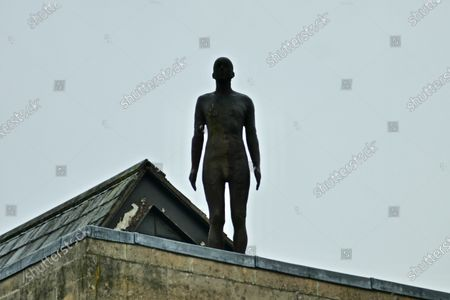 Anthony Gormley's statue looks out on Oxford on a rainy day