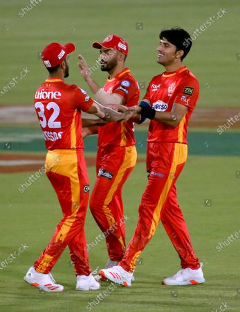 Islamabad United's Mohammad Wasim, right, celebrates with teammates after taking the wicket of Multan Sultans' Shahid Afridi during a Pakistan Super League T20 cricket match between Multan Sultans and Islamabad United at the National Stadium, in Karachi, Pakistan