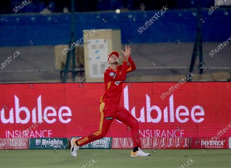 Islamabad United's Alex Hales takes a catch of Multan Sultans' Khushdil Shah during a Pakistan Super League T20 cricket match between Multan Sultans and Islamabad United at the National Stadium, in Karachi, Pakistan