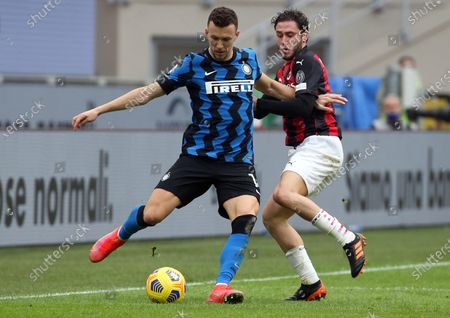 Stock Photo of Inter Milan's Ivan Perisic (L) challenges for the ball with AC Milan's Davide Calabria during the Italian Serie A soccer match between AC Milan and FC Inter at Giuseppe Meazza stadium in Milan, Italy, 21 February 2021.