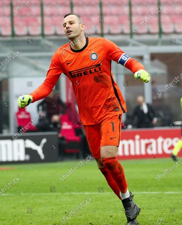 FC Inter's goalkeeper Samir Handanovic celebrates at the end of the Italian Serie A soccer match AC Milan vs FC Inter at the Giuseppe Meazza Stadium in Milan, Italy, 21 February 2021.