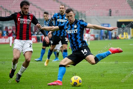 Inter's midfielder van Perisic and Milan's defender Davide Calabria during the Italian Serie A soccer match AC Milan vs FC Inter at the Giuseppe Meazza Stadium in Milan, Italy, 21 February 2021.