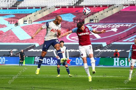 Lucas Moura (L) of Tottenham scores a goal during the English Premier League soccer match between West Ham United and Tottenham Hotspur in London, Britain, 21 February 2021.