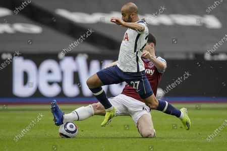Declan Rice (R) of West Ham in action against Lucas Moura (L) of Tottenham during the English Premier League soccer match between West Ham United and Tottenham Hotspur in London, Britain, 21 February 2021.