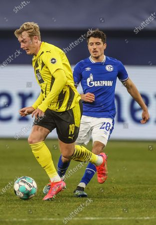 Stock Photo of Julian Brandt (L) of Dortmund vies with Alessandro Schoepf of Schalke 04 during a German Bundesliga football match between Borussia Dortmund and FC Schalke 04 in Gelsenkirchen, Germany, Feb. 20, 2021. (Photo by Tim Rehbein/Pool/handout via Xinhua) FOR EDITORIAL USE ONLY. GERMANY OUT. - Xin Huashefa -