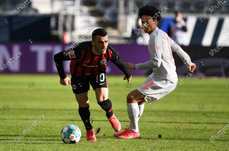 Leroy Sane (R) of Munich vies with Filip Kostic of Frankfurt during a German Bundesliga football match between Eintracht Frankfurt and FC Bayern Munich in Frankfurt, Germany, Feb. 20, 2021. (Photo by Jan Huebner/Pool/handout via Xinhua) FOR EDITORIAL USE ONLY. GERMANY OUT. - Xin Huashefa -