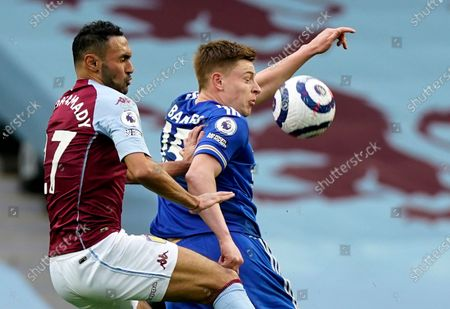 Aston Villa's Ahmed Elmohamady, left, challenges Leicester's Harvey Barnes during the English Premier League soccer match between Aston Villa and Leicester City at Villa Park in Birmingham, England