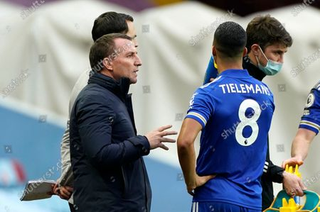 Leicester's manager Brendan Rodgers talks to Leicester's Youri Tielemans during the English Premier League soccer match between Aston Villa and Leicester City at Villa Park in Birmingham, England