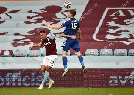 Aston Villa's Ahmed Elmohamady, left, challenges Leicester's Luke Thomas during the English Premier League soccer match between Aston Villa and Leicester City at Villa Park in Birmingham, England
