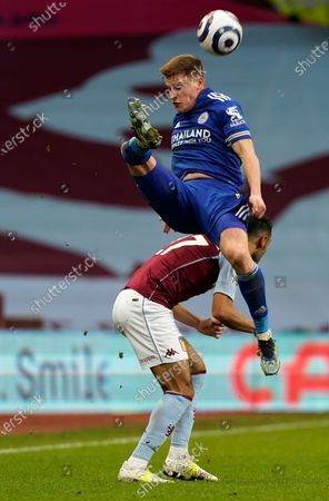 Leicester's Harvey Barnes, up, goes over Aston Villa's Ahmed Elmohamady during the English Premier League soccer match between Aston Villa and Leicester City at Villa Park in Birmingham, England