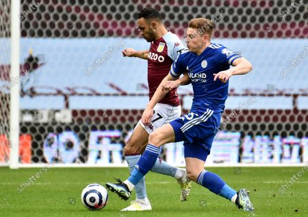 Leicester's Harvey Barnes, right, challenges Aston Villa's Ahmed Elmohamady during the English Premier League soccer match between Aston Villa and Leicester City at Villa Park in Birmingham, England