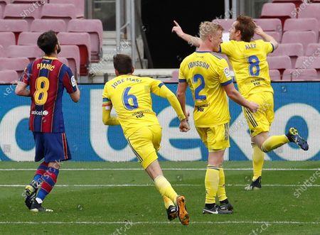 Cadiz's Alex Fernandez (R) celebrates after scoring the 1-1 goal during the Spanish La Liga soccer match held between FC Barcelona and Cadiz CF at the Camp Nou stadium in Barcelona, Spain, 21 February 2021.
