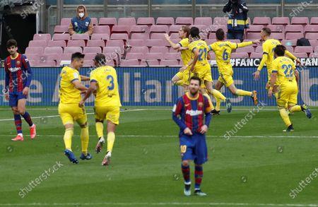 Cadiz's Alex Fernandez (C) celebrates with teammates after scoring the 1-1 goal during the Spanish La Liga soccer match held between FC Barcelona and Cadiz CF at the Camp Nou stadium in Barcelona, Spain, 21 February 2021.