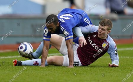 Matt Targett (bottom) of Aston Villa in action against Ricardo Pereira (up) of Leicester during the English Premier League soccer match between Aston Villa and Leicester City in Birmingham, Britain, 21 February 2021.