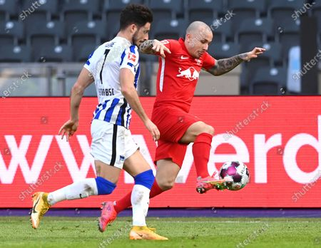 Hertha's Mathew Leckie (L) in action against Leipzig's Jose Angelino (R) during the German Bundesliga soccer match between Hertha BSC and RB Leipzig in Berlin, Germany, 21 February 2021.