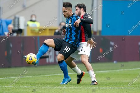 Stock Picture of Inter Milan's Lautaro Martinez, left, is challenged by AC Milan's Davide Calabria during the Serie A soccer match between AC Milan and Inter Milan, at the Milan San Siro Stadium, Italy