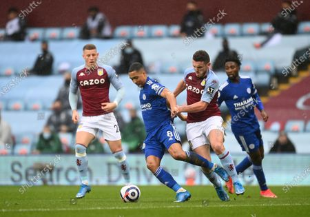 John McGinn (C-R) of Aston Villa in action against Youri Tielemans (C-L) of Leicester  during the English Premier League soccer match between Aston Villa and Leicester City in Birmingham, Britain, 21 February 2021.