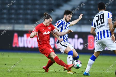 Leipzig's Marcel Sabitzer, left, and Berlin's Mathew Leckie, center, challenge for the ball during the German Bundesliga soccer match between Hertha BSC Berlin and RB Leipzig in Berlin, Germany