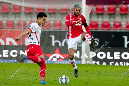 Stock Photo of Essevee's Cameron Humphreys and Standard's Mehdi Carcela fight for the ball during a soccer match between SV Zulte-Waregem and Standard de Liege, Sunday 21 February 2021 in Waregem, on day 27 of the 'Jupiler Pro League' first division of the Belgian championship.