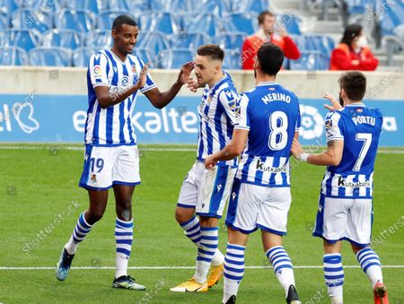 Stock Image of Real Sociedad's striker Alexander Isak (L) celebrates with teammates after scoring the 3-0 goal during the Spanish LaLiga soccer match between Real Sociedad and Deportivo Alaves held at Reale Arena stadium in San Sebastian, northern Spain, 21 February 2021.