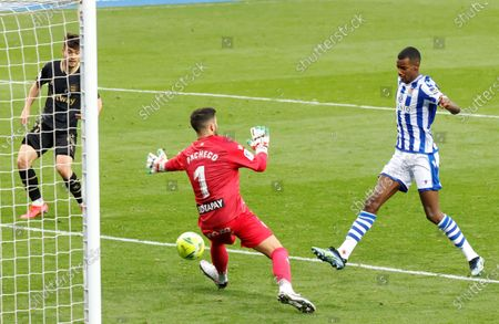 Stock Photo of Real Sociedad's striker Alexander Isak (R) scores the 3-0 goal during the Spanish LaLiga soccer match between Real Sociedad and Deportivo Alaves held at Reale Arena stadium in San Sebastian, northern Spain, 21 February 2021.