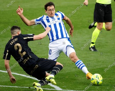 Real Sociedad's striker Mikel Oyarzabal (R) vies for the ball with Alaves' defender Alberto Rodriguez 'Tachi' (L) during the Spanish LaLiga soccer match between Real Sociedad and Deportivo Alaves held at Reale Arena stadium in San Sebastian, northern Spain, 21 February 2021.