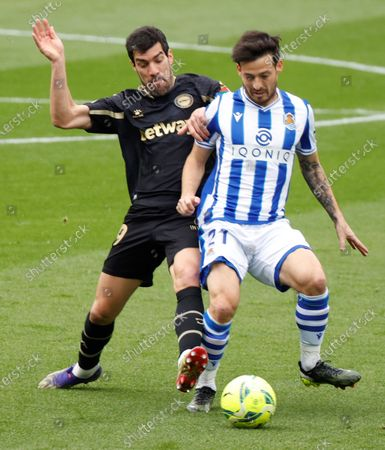 Stock Picture of Real Sociedad's midfielder David Silva (R) vies for the ball with Alaves' midfielder Manu Garcia (L) during the Spanish LaLiga soccer match between Real Sociedad and Deportivo Alaves held at Reale Arena stadium in San Sebastian, northern Spain, 21 February 2021.