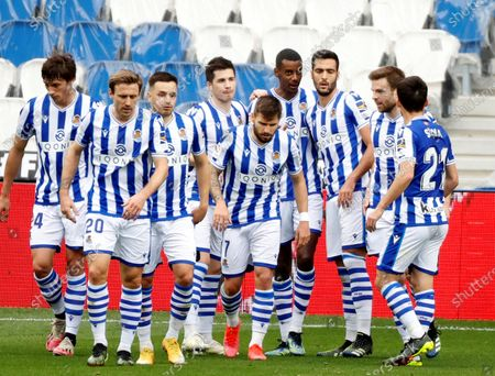 Real Sociedad's striker Alexander Isak (4-R) celebrates with teammates after scoring the 1-0 lead during the Spanish LaLiga soccer match between Real Sociedad and Deportivo Alaves held at Reale Arena stadium in San Sebastian, northern Spain, 21 February 2021.