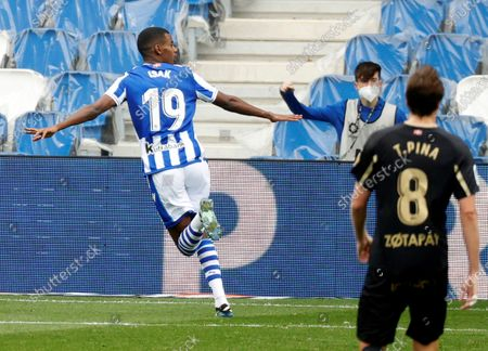 Real Sociedad's striker Alexander Isak (L) celebrates after scoring the 1-0 lead during the Spanish LaLiga soccer match between Real Sociedad and Deportivo Alaves held at Reale Arena stadium in San Sebastian, northern Spain, 21 February 2021.