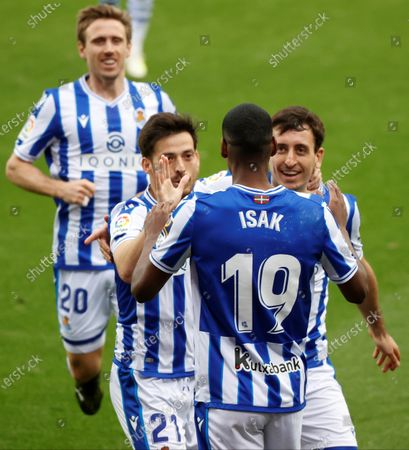 Real Sociedad's striker Alexander Isak (C) celebrates with teammates after scoring the 2-0 goal during the Spanish LaLiga soccer match between Real Sociedad and Deportivo Alaves held at Reale Arena stadium in San Sebastian, northern Spain, 21 February 2021.