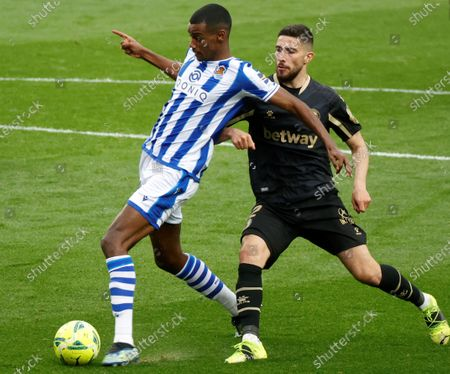 Real Sociedad's striker Alexander Isak (L) scores the 2-0 goal  during the Spanish LaLiga soccer match between Real Sociedad and Deportivo Alaves held at Reale Arena stadium in San Sebastian, northern Spain, 21 February 2021.