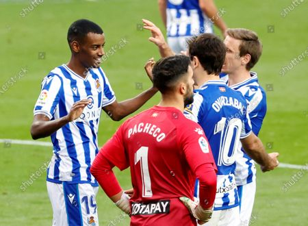 Real Sociedad's striker Alexander Isak (L) celebrates with teammates after scoring the 3-0 goal during the Spanish LaLiga soccer match between Real Sociedad and Deportivo Alaves held at Reale Arena stadium in San Sebastian, northern Spain, 21 February 2021.