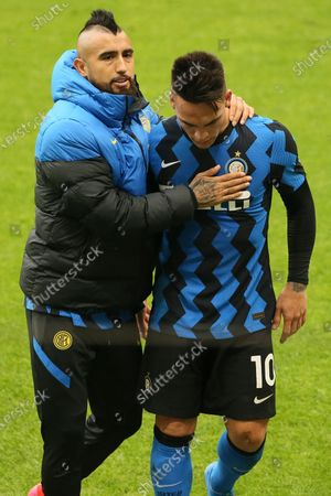 Arturo Vidal of FC Internazionale celebrates with Lautaro Martinez during the Serie A match between AC Milan and FC Internazionale at Stadio Giuseppe Meazza on February 21, 2021 in Milan, Italy.