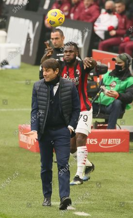 Stock Image of Antonio Conte of FC Internazionale and Franck Kessie of AC Milan during the Serie A match between AC Milan and FC Internazionale at Stadio Giuseppe Meazza on February 21, 2021 in Milan, Italy.