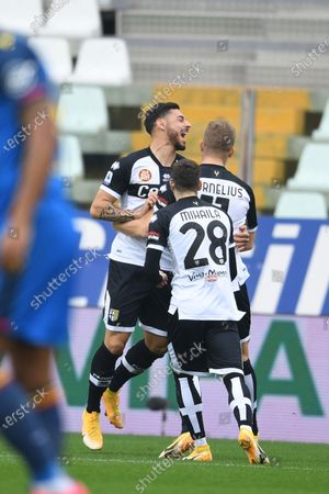 "Valentin Mihaila (Parma)Giuseppe Pezzella (Parma)Andreas Evald Cornelius (Parma)  celebrates after scoring his team's first goal             during the Italian ""Serie A match between Parma 2-2 Udinese at  Ennio Tardini Stadium in Parma, Italy."