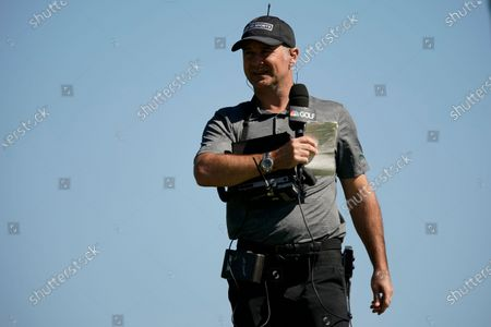 Stock Photo of Sports and Golf Channel course announcer Trevor Immelman, of South Africa, is seen on the third hole during the final round of the Genesis Invitational golf tournament at Riviera Country Club, in the Pacific Palisades area of Los Angeles
