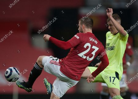 Luke Shaw of Manchester United (L) and Emil Krafth of Newcastle United in action