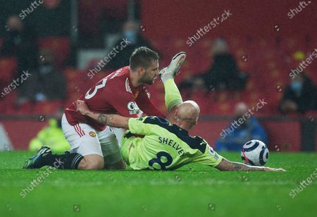 Stock Image of Luke Shaw of Manchester United (L) and Jonjo Shelvey of Newcastle United in action