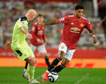 Stock Photo of Manchester United's Marcus Rashford (R) in action against Newcastle's Jonjo Shelvey (L) during the English Premier League soccer match between Manchester United and Newcastle United in Manchester, Britain, 21 February 2021.