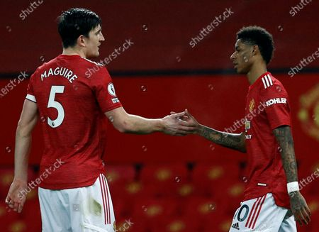 Manchester United's Marcus Rashford (R) celebrates with Harry Maguire (L) after scoring the 1-0 during the English Premier League soccer match between Manchester United and Newcastle United in Manchester, Britain, 21 February 2021.