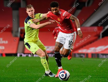Manchester United's Marcus Rashford (R) in action against Newcastle's Emil Krafth (L) during the English Premier League soccer match between Manchester United and Newcastle United in Manchester, Britain, 21 February 2021.