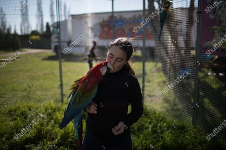 Circus performer Sophie Kerwich kisses a parrot at the Royal Circus based in Senas, southern France, . As circuses continue to sit idle due to coronavirus restrictions French lawmakers are debating an animal welfare bill that would ban using wild animals in traveling circuses