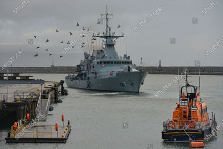 LÉ Samuel Beckett (P61), an offshore patrol vessel of the Irish Naval Service next to Dun Laoghaire Lifeboat, seen from in Dun Laoghaire during Level 5 Covid-19 lockdown.